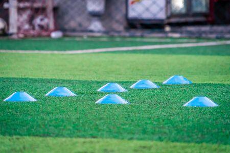 Blue Plastic sport marker on sport field ground for sport training.