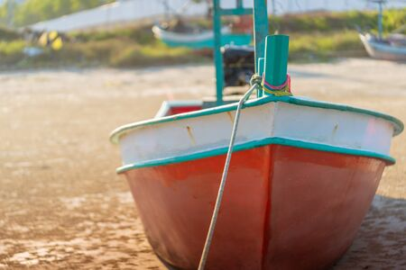 Thai wooden Fishing boat on an island sand beach for Vacation and Beach travel cocnept. Stock fotó