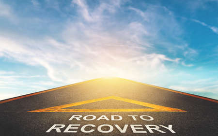 Road to recovery concept for business and health concept with Blue cloud sky background. Stock Photo