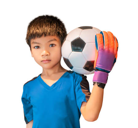 Asian boy is a football goalkeeper wearing gloves and holding a soccer ball isolated on white.