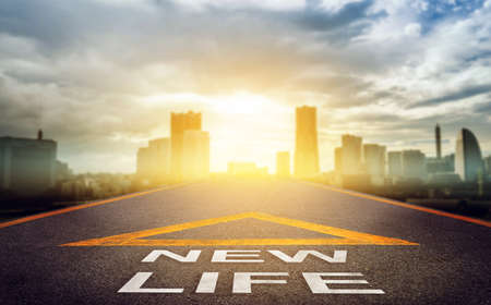 New life road signage leading to a bright golden modern city for New Business begining concept.