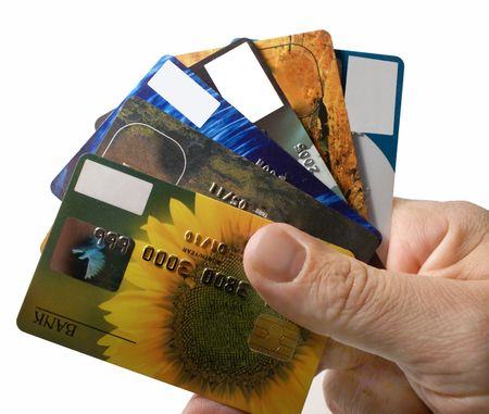 credit cards: Bunch  of credit cards in mans hand            Stock Photo