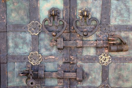 pastiche: Details of a  wrought  door conventionalized to antiquities Stock Photo