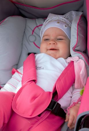bassinet: Little girl in pink-white clothes in lying in cradle Stock Photo