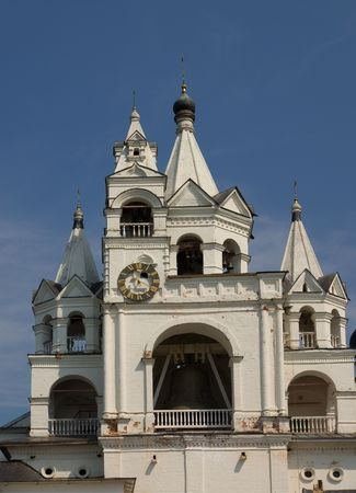 Belltower with clock in Savvino-Storoghevskiy monastery in Zvenigorod near Moscow, Russia