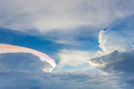 irisation, bright beautiful blue sky with Rainbow Clouds