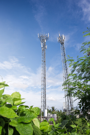 metal structure: Telecommunication tower with antennas with blue sky repeater antenna, Mobile phone network antenna