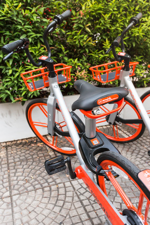 Mobike bicycles, Public bicycle parked in public area for tourists and people interested in borrowing to ride in the city and rent by QR code and mobile application technology. BANGKOK, THAILAND, Feb 22, 2018