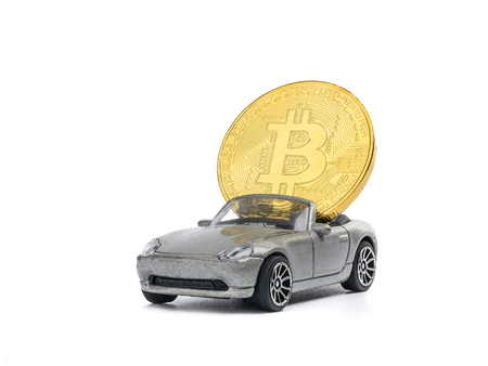 Bitcoins on the car model isolated on white background. view from above with text copy space
