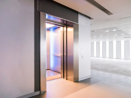 Modern elevator open doors in a empty floor, Large Hall, Store, interior,Lab, without furniture in a new building. Stock Photo