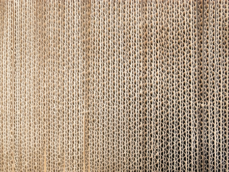 corrugated cardboard for packing, abstract background vertical lines, package paper or cardboard. Stock Photo