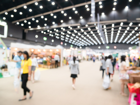 Abstract blurred, defocused background of public event exhibition hall, business, people in exhibition hall event trade show background