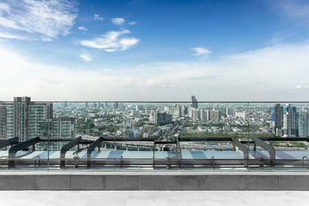 empty terrace, roof top balcony in the building with cityscape background, bangna bangkok Thailand.