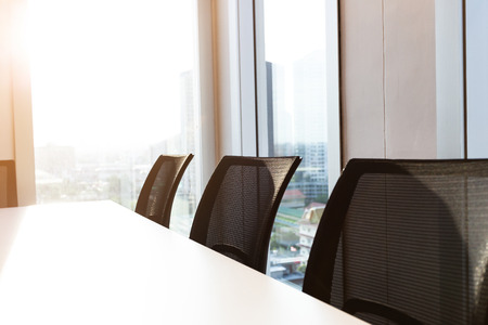 Row office chair in modern meeting room executive office with large windows, black office chair, outside building, city, tower view, soft focus.