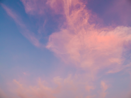 Sunset time romantic pink clouds with blue sky. Stock Photo
