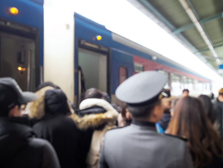 railtrack: Defocused image of people at a railway station traveling by train Stock Photo