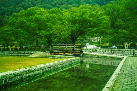 manmade: kikko park in the iwakuni area japan manmade water with small bridge