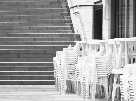 Stacked white chairs  Stock Photo