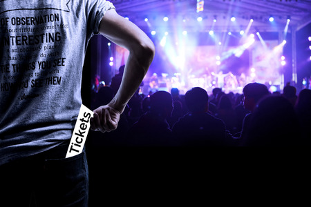 live event: Audience presenting tickets or admission passes watch a concert
