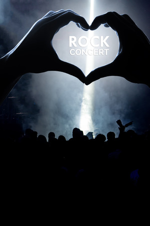 heart shaped shadow of Audience at rock concert