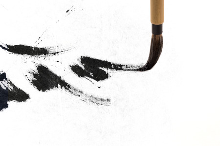 Chinese brushes draw on white papers Imagens