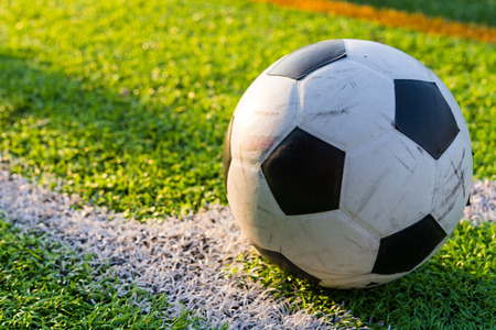 premier league: football in green grass field on conner ready for kick