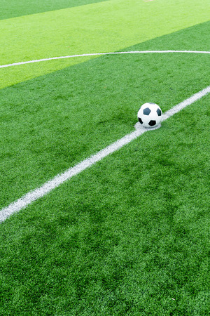 kick off: soccer field grass with ball at kick off point.