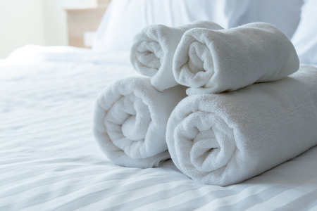 fold: white bath towels in bed room, Room service