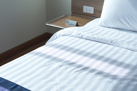 white sheet: clean bed sheets and pillows with morning lighting
