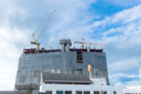 construction project: blurred image of construction site with crane