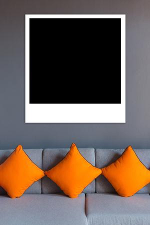 interior desing: Black Photos on top living room sofa