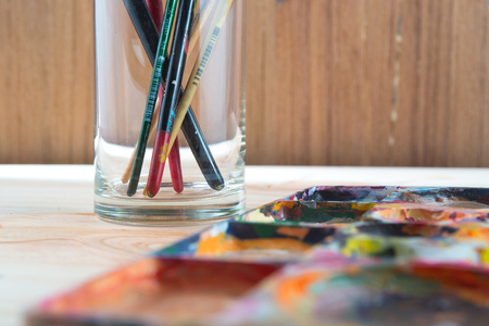 paint box: Paint brushes and paint box, artist tools Stock Photo