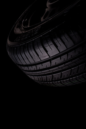background black: Car tire isolated on over black background