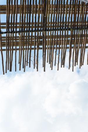truss: wooden roof truss blue sky clouds backgrounds