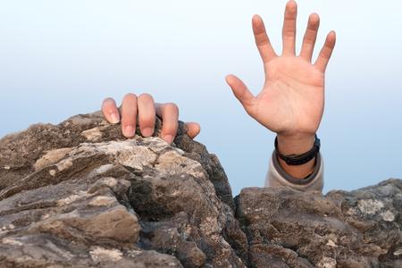 hand for help rock climbing