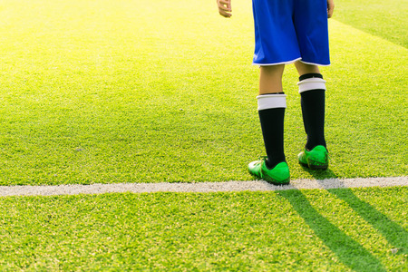 kick off: Soccer player ready to play at kick off the game in soccer field