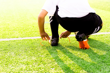 kick off: Soccer player ready to play at kick off the game in soccer field background sunset, kick off soccer game