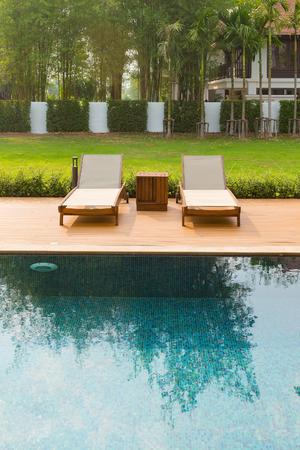 Pool bed beside the tropical resort swimming pool Standard-Bild