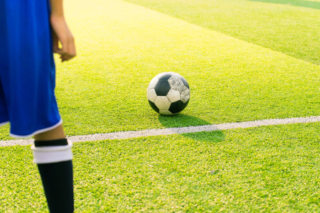 kick off: Soccer player ready to play at kick off the game in soccer field, background sunset, kick off, soccer game