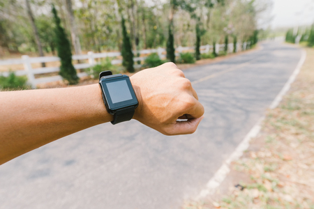 Close-up smart watch on arm traveller using GPS, navigation concept