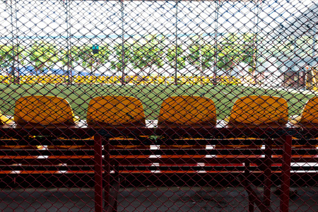 indoor soccer: football substitutes seats in indoor soccer stadium.