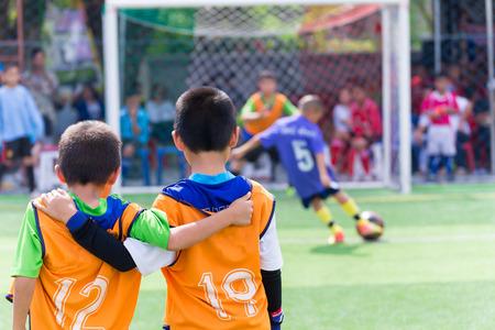 Young boy player waiting for kick a ball, football soccer match for children