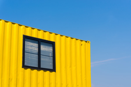 yellow container with background blue sky Stock Photo
