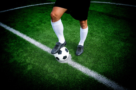 kick off: Soccer player ready to play at start kick off point in soccer field. Stock Photo