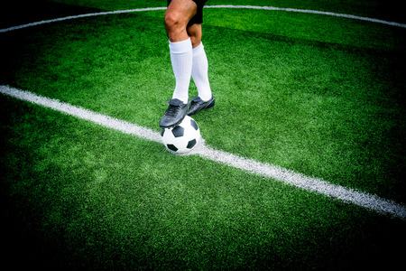 Soccer player ready to play at kick off point in soccer field. Stock Photo