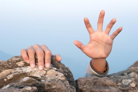 hands for help rock climbing Standard-Bild