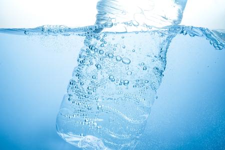 Bottle in under clean drinking water Stock Photo