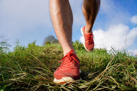 close-up Foot athlete Trail running workout on rocky terrain outdoors for fitness and healthy lifestyle