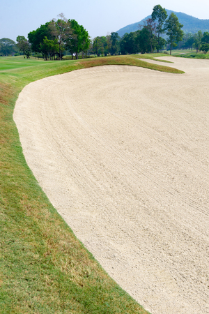 Golf course with the sand bunker