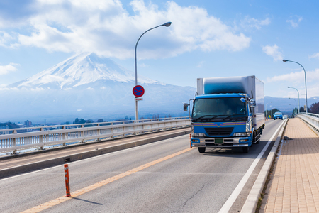 Car Truck Run Through Bridge in Kawaguchiko Lake, Logistics in City, Yamanashi, Japan